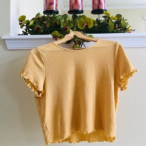 I'm selling a yellow American Eagle crop top.